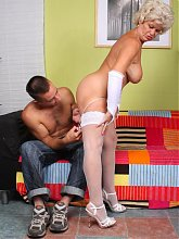 Sexy granny Francesca unleashes her big knockers to lure a younger guy into fucking her cunt