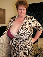 Huge breasted housewife playing with a toy