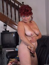 Mature redhead showing off her tits and cunt