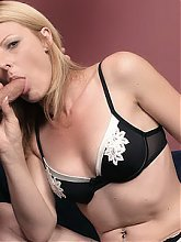 Horny blonde MILF Isadora warms up a fat cock with her mouth and dishes out her shaved muff