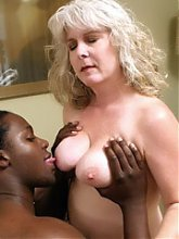 Experienced mature MILF Stacey goes down on all fours in bed for a huge black wang