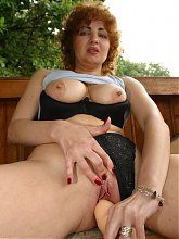 Redhead granny exposes her pair of big breasts and masturbates with a dildo live