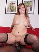 Maxia dons her pair of nylons and parts her thighs for a BBC during a webcam session