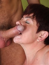 Redhead grandma with big boobs Simone sucking and taking a cock inside her wrinkled pussy