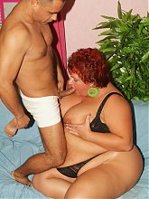 Naughty mature chick Agnes spreading her fat thighs while a cock probes her cushioned cunt