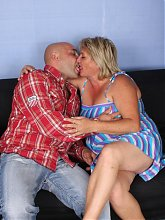 Horny older gal Sussana seduces a younger guy with her pair of fat tits and gets cum hosed