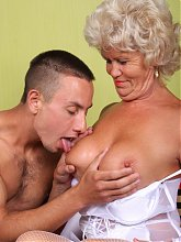 Hefty granny Francesca joins a younger guy in the couch for an intense live sex show